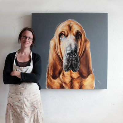 Justine, dog portrait painter in the studio